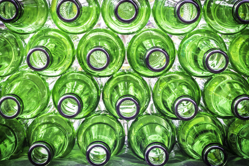 44219093 - closeup  empty of green bottle beer background